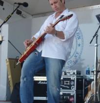 Vance Mizzi playing guitar